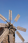 Ancient log windmill over clear blue sky Ukraine Eastern Europe Countryside Vertical orientation