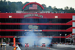 Jun. 18, 2011; Bristol, TN, USA: NHRA funny car driver Cruz Pedregon (left) does his burnout alongside Bob Tasca III during qualifying for the Thunder Valley Nationals at Bristol Dragway. Mandatory Credit: Mark J. Rebilas-