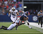 Ole Miss' Marcus Temple (4) is tackled by Southern Illinois' Ray Agnew (46) following an interception at Vaught-Hemingway Stadium in Oxford, Miss. on Saturday, September 10, 2011.