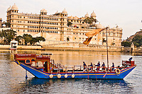 Exterior view of The City Palace, with Royal Barge in the foreground on Lake Pichola. (Photo by Matt Considine - Images of Asia Collection)