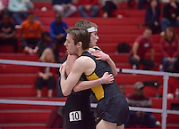 NWA Democrat-Gazette/BEN GOFF @NWABENGOFF<br /> Alex George, running unattached, hugs his brother Thomas George of Missouri after the 1 mile run invitational Friday, Feb. 10, 2017 during the Tyson Invitational at the Randal Tyson Track Complex in Fayetteville.