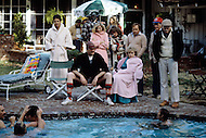 Los Angeles, CA, Summer 1982. The Osterman Weekend is a 1983 suspense thriller film directed by Sam Peckinpah. The film stars Rutger Hauer, John Hurt, Burt Lancaster, Dennis Hopper, Meg Foster and Craig T. Nelson. It was Peckinpah's final film before his death in 1984. Swiming pool scene with most of the actors and Sam Peckinpah.