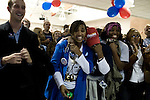 November 4, 2008. Greensboro, NC.. As news that NBC had called the presidential election for Democrat Barack Obama, people at a Democratic election watching party were overwhelmed.. Simone Hawks, left, reacted with friends, including Zim Ugochukwu, right.
