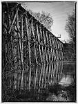 The railroad trestle bridge crossing the Rabbit River in Hamilton, Michigan. Photo by Dan Irving.