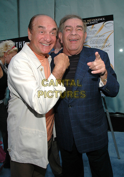 """FREDDIE ROMAN & DICK CAPRI.""""The Aristocrats"""" Premiere,.The Directors Guild Theater,.New York, 26th July 2005.half length half-length black t-shirt white shirt blue check jacket point pointing funny.www.capitalpictures.com.sales@capitalpictures.com.© Capital Pictures."""