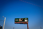Golfer Phil Mickelson is seen on a billboard along Washington Road above traffic heading to The Masters golf tournament on its first practice day at The Augusta National Golf Club in Augusta, Georgia April 15, 2010.