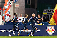 Aurelien Collin (78) of Sporting Kansas City celebrates scoring with teammates during a Major League Soccer (MLS) match at Red Bull Arena in Harrison, NJ, on April 17, 2013.