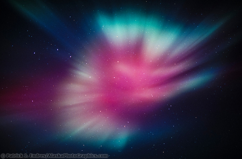 The Big Dipper Constellation is in the center of Aurora Borealis corona display, Fairbanks, Alaska. Aurora corona as seen when standing directly below a bundle of parallel plasma-channeling magnetic field lines that are converging on a point high in the sky. Alaska's Brooks range, Arctic, Alaska