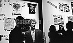 """September 14, 1988:  Malcolm McLaren (1946 2010) center, in front of an installation of Sex Pistols ephemera, including t-shirts he designed with Vivienne Westwood, at the opening reception of his exhibition at the New Museum of Contemporary Art in New York City, titled """"Impresario: Malcolm McLaren and the British New Wave""""."""