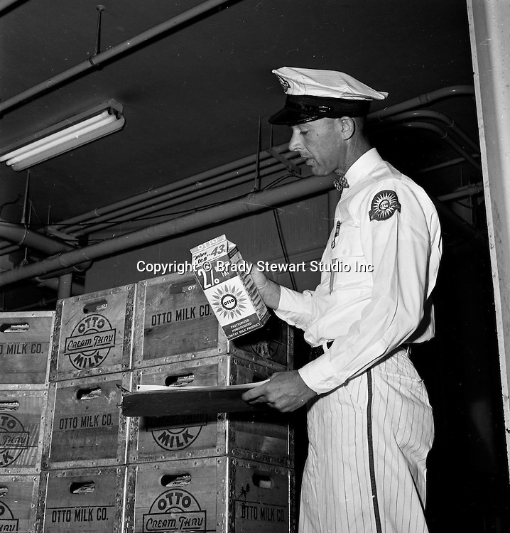 Pittsburgh PA - Otto Milk delivery man signing off on a shipment at the Otto Milk warehouse in the Strip District - 1965.   Location assignment for Ketchum McLeod and Grove Advertising