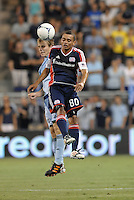 Fernando Cardenas (80)  forward New England Revolution goes up for a header with Seth Sinovic (16) defender Sporting KC..Sporting Kansas City and New England Revolution played to a 0-0 tie at LIVESTRONG Sporting Park, Kansas City, KS.