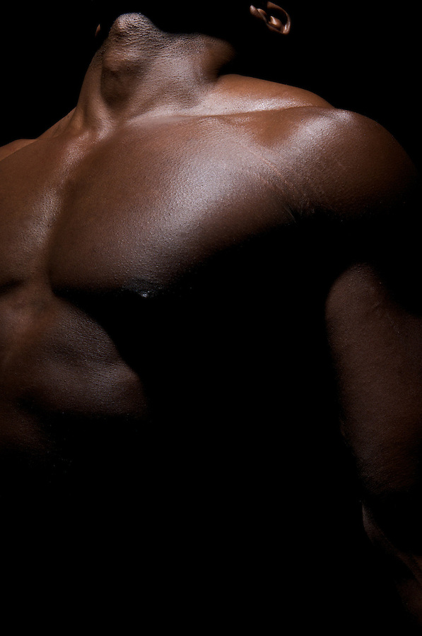 Close up of  worked out torso of an African American Young.