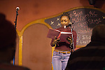"""Kaitlin C. Wilson reads a poem at """"Creative Arts as Activism – Social Justice-Themed Open Mic Night,"""" at Casa Nueva Restaurant and Cantina on January 20, 2016. Wilson was also the emcee for the event. ©Ohio University/Photo by Kaitlin Owens"""