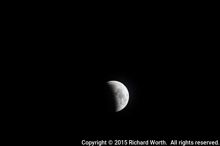 A lunar eclipse, in progress.  One hour away from maximum on April 5, 2015.  Viewed from near San Francisco, California.