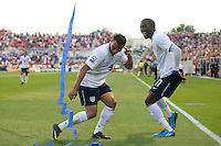 Jozy Altidore, right, and Charlie Davies, left, of the USA celebrate Altidore's winning goal against El Salvador during a World Cup Qualifying match at Rio Tinto Stadium, in Sandy, Utah, Friday, September 5, 2009.  .The USA won 2-1.