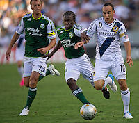 CARSON, CA - June 17, 2012: Portland Timbers defender Jack Jewsbury (13), midfielder Diego Chara (21) and LA Galaxy forward Landon Donovan (10) during the LA Galaxy vs Portland Timbers match at the Home Depot Center in Carson, California. Final score LA Galaxy 1, Portland Timbers 0.