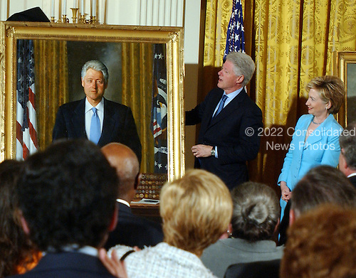 Former United States President Bill Clinton unveils his White House portrait as his wife, United States Senator Hillary Rodham Clinton (Democrat of New York) looks on. .Credit: Ron Sachs / CNP