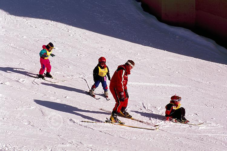 Young Children learning to Downhill Ski with Instructor, at Big White Ski Resort near Kelowna, in the Thompson Okanagan Region, British Columbia, Canada