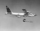 1959 photo of an X-15 launch from its B-52 mothership.   This joint program by the National Aeronautics and Space Administration (NASA), the United States Air Force, the United States Navy, and North American Aviation, Inc. operated the most remarkable of all the rocket research aircraft. Composed of an internal structure of titanium and a skin surface of a chrome-nickel alloy known as Inconel X, the X-15 had its first, unpowered glide flight on June 8, 1959, while the first powered flight took place on September 17, 1959. Because of the large fuel consumption of its rocket engine, the X-15 was air launched from a B-52 aircraft at about 45,000 ft and speeds upward of 500 mph. The airplane first set speed records in the Mach 4-6 range with Mach 4.43 on March 7, 1961; Mach 5.27 on June 23, 1961; Mach 6.04 on November 9, 1961; and Mach 6.7 on October 3, 1967. It also set an altitude record of 354,200 feet (67 miles) on August 22, 1963, and provided an enormous wealth of data on hypersonic air flow, aerodynamic heating, control and stability at hypersonic speeds, reaction controls for flight above the atmosphere, piloting techniques for reentry, human factors, and flight instrumentation. The highly successful program contributed to the development of the Mercury, Gemini, and Apollo piloted spaceflight programs as well as the Space Shuttle program. The program's final flight was performed on October 24, 1968.