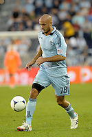 Aurelien Collin (78) Sporting KC defender in action... Sporting KC defeated FC Dallas 2-1 at LIVESTRONG Sporting Park, Kansas City, Kansas.