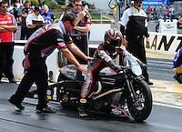 May 6, 2012; Commerce, GA, USA: NHRA crew members for pro stock motorcycle rider Eddie Krawiec during the Southern Nationals at Atlanta Dragway. Mandatory Credit: Mark J. Rebilas-