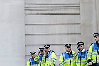 Police monitor the demonstrations from the Bank of England as thousands of protestors descended on the City of London ahead of the G20 summit of world leaders to express anger at the economic crisis, which many blame on the excesses of capitalism.