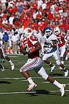 UofL's Doug Beaumont runs the ball against UK at Papa John's Cardinal Stadium on Saturday, Sept. 4, 2010. Photo by Scott Hannigan | Staff