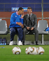 The injured Rio Ferdinand and David Beckham share a laugh prior to the game with the USA. USA vs England in the 2010 FIFA World Cup in Rustenburg, South Africa on June 12, 2010.