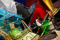 Members of a samba school work on a carnival float inside the workshop in Rio de Janeiro, Brazil, 15 February 2012. The carnival preparations start early in July or August, some 7-8 months before the main samba schools parade at the sambodrome. Samba schools hire teams of professional designers and artists who, according to the original theme selected by the school directors and then featured by the school during the parade, create allegorical floats, costumes, sculptures, music, choreography and the entire school show. However, the most of the everyday work in the carnival hangars is performed by unknown but fully dedicated samba schools members.
