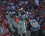 Ole Miss defensive tackle Bryon Bennett (95) and Ole Miss defensive end Cameron Whigham (55) celebrate a sack of Georgia quarterback Aaron Murray (11) at Sanford Stadium in Athens, Ga. on Saturday, November 3, 2012.