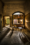 Abandoned lunatic asylum north of Berlin, Germany. Chairs in empty room.