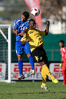 Jason Wright (10) of Jamaica goes up for a header with Jose Barralaga (13) of Honduras during the quarterfinals of the CONCACAF Men's Under 17 Championship at Catherine Hall Stadium in Montego Bay, Jamaica. Jamaica defeated Honduras, 2-1.