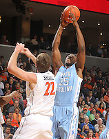 Jan. 8, 2011; Charlottesville, VA, USA; North Carolina Tar Heels forward Justin Knox (25). reaches for the rebound with Virginia Cavaliers forward Will Sherrill (22)  during the game at the John Paul Jones Arena. Mandatory Credit: Andrew Shurtleff-