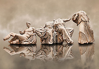 Figures from the East Pediment of the Parthenon, Acropolis Athens. From left to right cat no D Dionysos ,middle E & F Demeter & Persephone, left G Hebe. British Museum London Exhibit