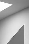 Interior design with images of simple shapes, patterns, walls, angles,celing and light.