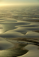 Late afternoon aerial of Lencois Maranhenses, an extensive dune system with pools of water between the dunes in Maranhao State in northeastern Brazil (Nordeste).