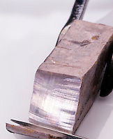 SODIUM METAL CUT WITH KNIFE<br /> Has silvery appearance when freshly cut but quickly tarnishes as it is exposed to air.