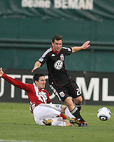 Stephen King #20 of D.C. United loses the ball to a sliding tackle from Sacha Kljestan #16 of Chivas USA during an MLS match at RFK Stadium, on May 29 2010 in Washington DC. United won 3-2.