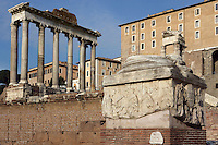 Decennalia Base, 303 AD, part of a five columns monument which was originally placed behind the imperial Rostra, Temple of Saturn (497 BC) and Temple of Vespasian (81 AD) in the background, Roman Forum, Rome, Italy, Europe.