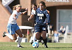 24 November 2007: Notre Dame's Courtney Rosen (14) is defended by North Carolina's Whitney Engen (9) and Yael Averbuch (behind). The University of Notre Dame Fighting Irish defeated University of North Carolina Tar Heels 3-2 at Fetzer Field in Chapel Hill, North Carolina in a Third Round NCAA Division I Womens Soccer Tournament game.