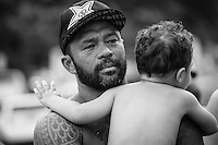 North Shore, Oahu, HAWAII - (Friday, Nov. 15, 2013) Sunny Garcia (HAW) the winner of the Clash of Legends with his grandson Sunny.-- A late afternoon glass-off coupled with excellent overhead waves saw underdog Brazilian Jesse Mendes (world rank: 63) steal the show at the REEF Hawaiian Pro today, when he posted the highest 2-wave combination of the event: 17.9 points out of 20 (9.2 and 8.7). Mendes, 20, from Sao Paulo, was close to flawless on his backhand attack of the famously fun break of Haleiwa. The REEF Hawaiian Pro is the first stop of the $960,000 Vans Triple Crown of Surfing.<br /> The contest has until November 23 to run four full days of competition where 128 of the world's best surfers will compete for critical ASP Prime points and a share of $250,000 prize money. The winner of this event will take home $40,000 and an early lead on the 2013 Vans Triple Crown series ratings. <br /> <br /> A bad day turned good for 6-time Vans Triple Crown champion Sunny Garcia (HAW) today, bowing out of the main event but getting the better of a fun reunion with three other legends of the sport to win the exhibition REEF Clash of the Legends. The $10,000 first prize definitely helped to lift his mood. His former tour traveling partner Kaipo Jaquias (HAW) was second; Michael Ho (HAW) was third; and California's Brad Gerlach (USA) was fourth. This was Garcia's second &quot;Clash&quot; title.Photo: joliphotos.com