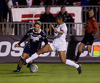 Melissa Henderson (6) of Notre Dame slides past Cassie Dickerson (13) of Ohio State during the first game of the NCAA Women's College Cup at WakeMed Soccer Park in Cary, NC.  Notre Dame defeated Ohio State, 1-0.