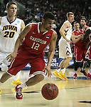 Davidson's Jack Gibbs (12) is turned away from the basket by Iowa's Jarrod Uthoff (20)  during 2015 NCAA Division I Men's Basketball Championship March 20, 2015 at the Key Arena in Seattle, Washington.  Iowa beat Davidson 83-52.   ©2015. Jim Bryant Photo. ALL RIGHTS RESERVED.