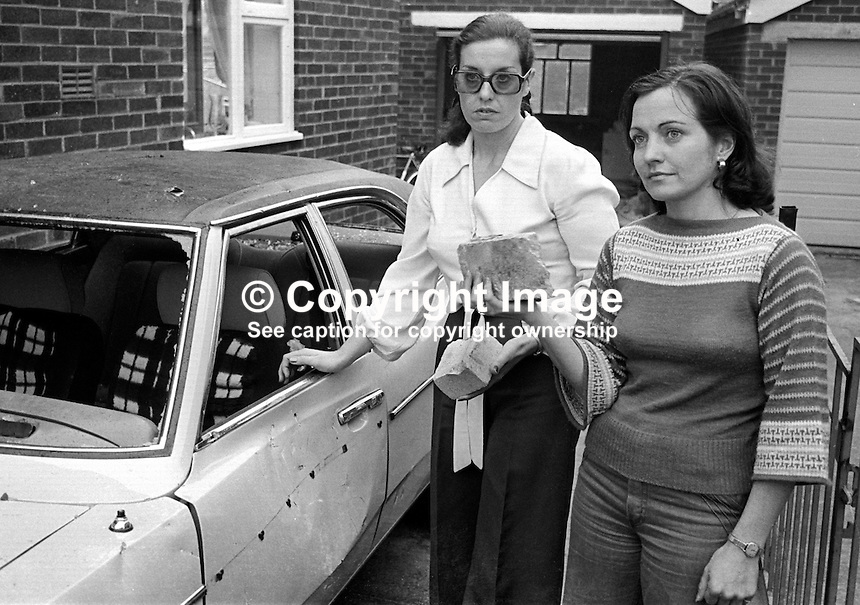 Not very peaceful for the Peace People, Betty Williams, left, and Mairead Corrigan. They are holding up bricks thrown at them when their car was attacked by youths in Turf Lodge, a largely republican area of Belfast, N Ireland. 10th October 1976, 197610100515a.<br /> <br /> Copyright Image from Victor Patterson, 54 Dorchester Park, Belfast, UK, BT9 6RJ<br /> <br /> t: +44 28 90661296<br /> m: +44 7802 353836<br /> vm: +44 20 88167153<br /> e1: victorpatterson@me.com<br /> e2: victorpatterson@gmail.com<br /> <br /> For my Terms and Conditions of Use go to www.victorpatterson.com