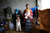 "54 year old Daw Hlamyint grabbed her 3 year old grand-daughter, Su Su Khing on one hand and the child's teddy bear on the other as she ran to take shelter from the cyclone. ""Su Su is very close to me and wouldn't spend anytime away from either me or her teddy bear, Pont Pont. I had to bring the teddy bear.""..Refugees from the 7th ward, Hlaing Thayar township take shelter in the Swethanlwin building shopping complex which is  under construction and has acted as a small refugee centre outside of capital Yangoon, Myanmar."