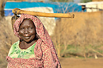 A woman in the Hamadiya camp for internally displaced families, filled with victims of the conflict in Sudan's Darfur region. ACT-Caritas supports families here with a variety of services, including a clinic and nutrition center.