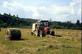 Bailing hay with a farm tractor