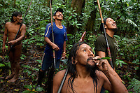 Omayuhue Baihua imitates a toucan, by blowing a piece of palm leaf, while hunting in the jungle near the Waorani (Huaroni) community of Boanamo. Many Waorani now hunt using shotguns instead of spears and blowpipes.