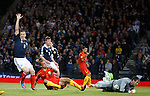 Macedonia's Nikolche Noveski scores the opener past Allan McGregor as Gary Caldwell appeals for offside