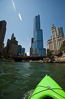The bow of my kayak points upriver toward the Trump International Hotel and Tower on the north bank of the Chicago River.